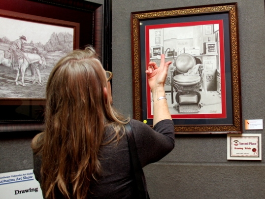 One of the attendees admiring a drawing during the 2012 Autumn Art Show.